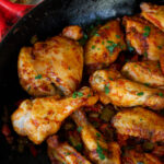 Pollo al chilindron (chicken with peppers) in skillet