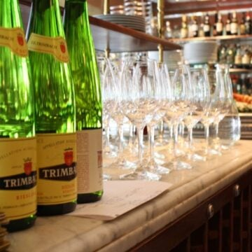 Bottles of reisling on bar at Bouchon Bistro in Yountville, California.