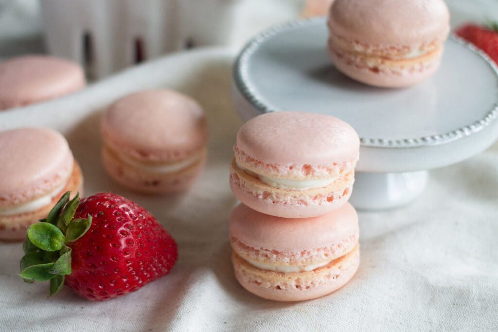 Strawberry macarons displayed on table