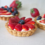 Fresh fruit tarts on counter from Edible Times