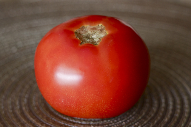 Red conventional tomato.