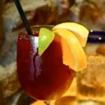 Red sangria in glass on table.