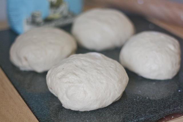 Beignet dough on counter.