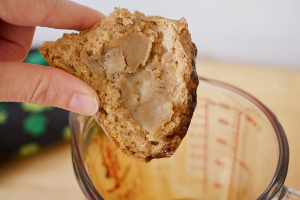 Piece of Irish soda bread spread with Guinness butter.