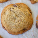 Paleo chocolate chip cookies on parchment paper.