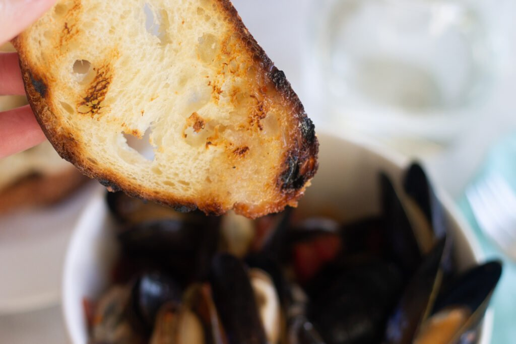 Mussels with toasted baguette.