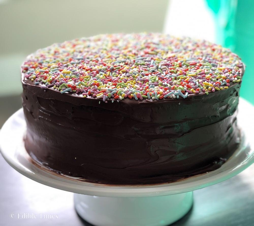 Chocolate cake with rainbow sprinkles on top.