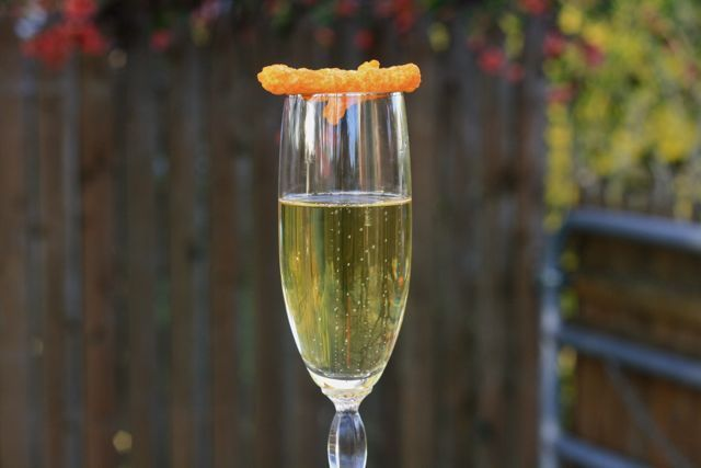 Champagne glass with Cheetos on top, Edible Times.
