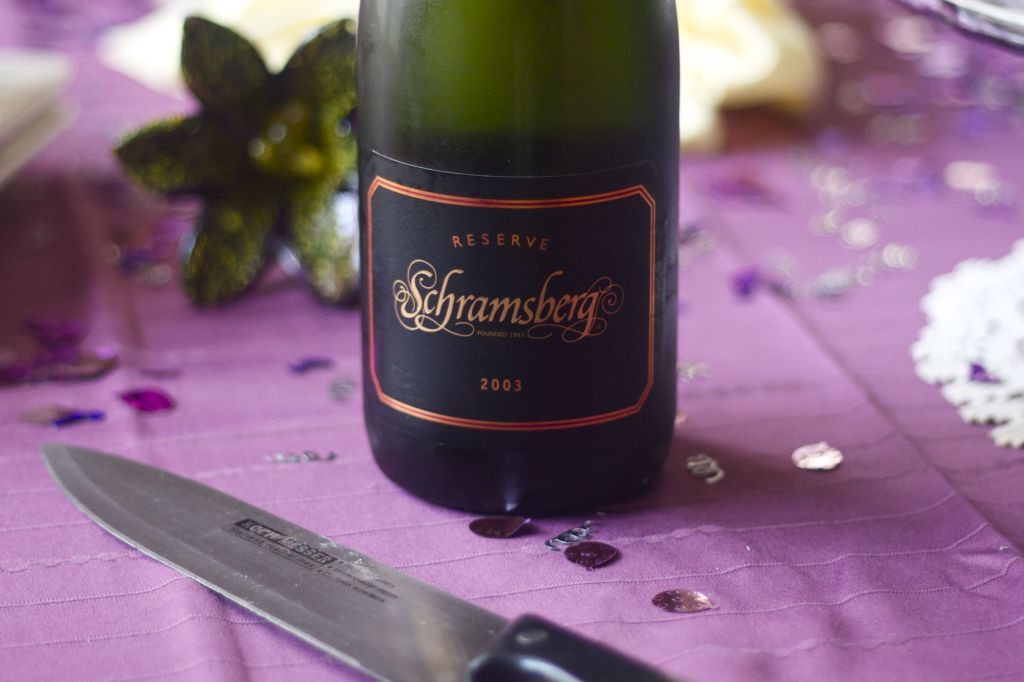 Bottle of Schramsberg Reserve sparkling wine on decorated table. Food and wine pairings. How to choose the best wine for your meal.