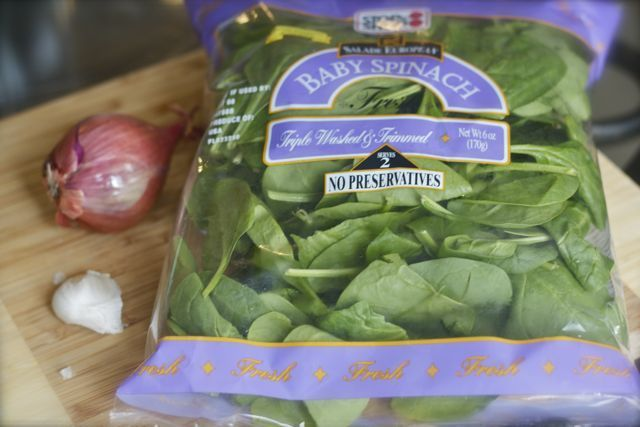 Bag of fresh baby spinach.
