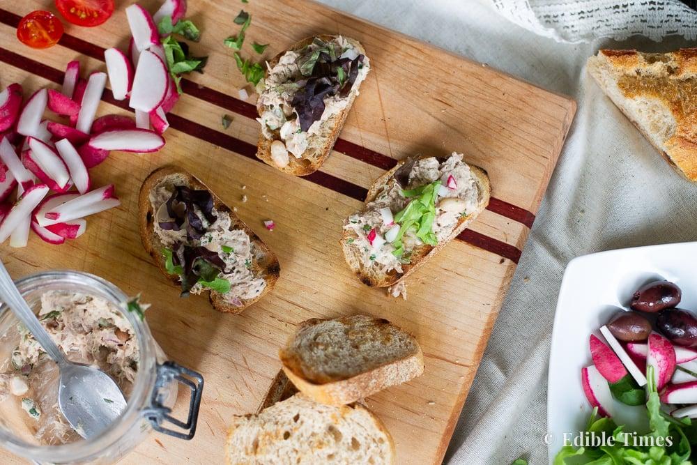Mini tuna tartines on cutting board.