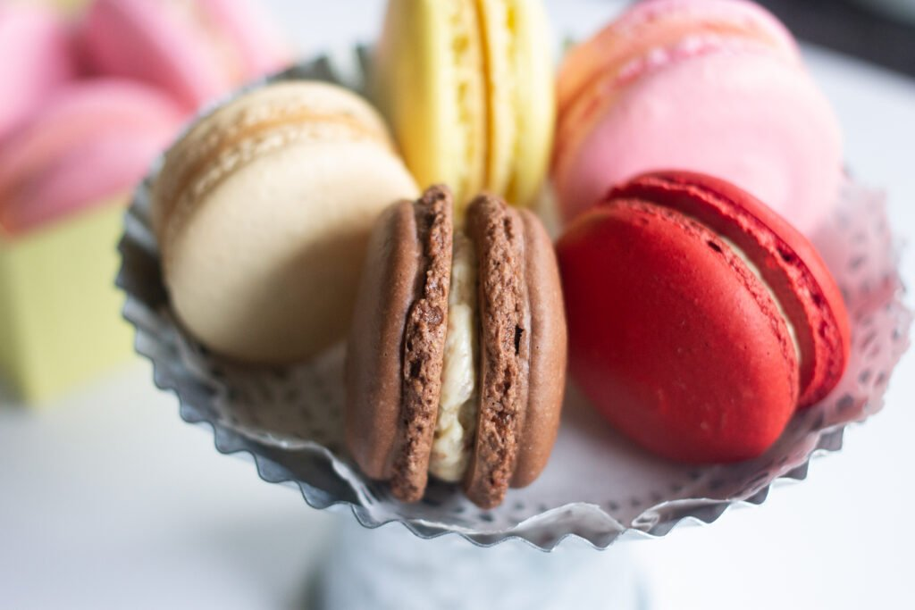Mini tin cake plate with a variety of French macarons.