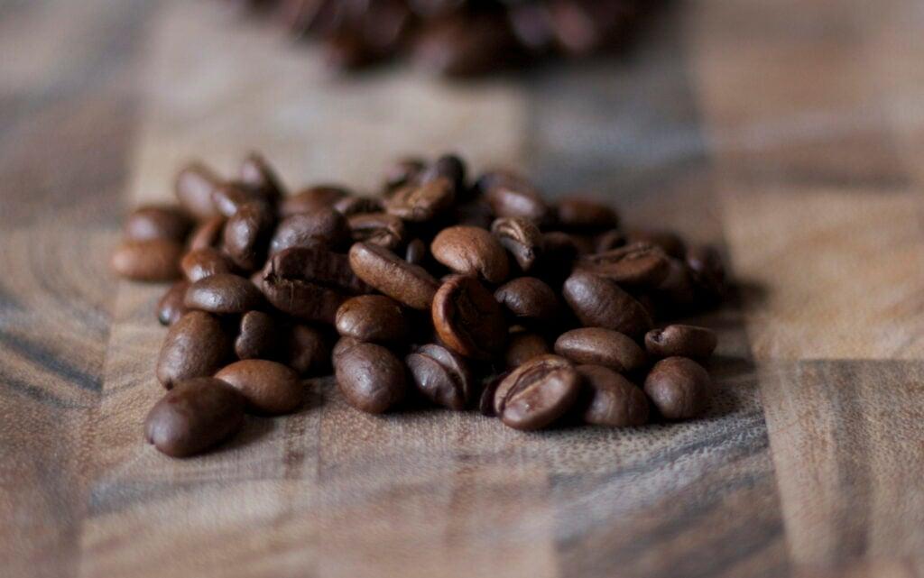 Fair trade coffee beans on cutting board.