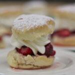 Strawberry shortcakes on white plates.