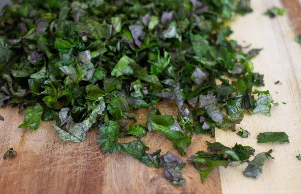 Chopped kale on cutting board.