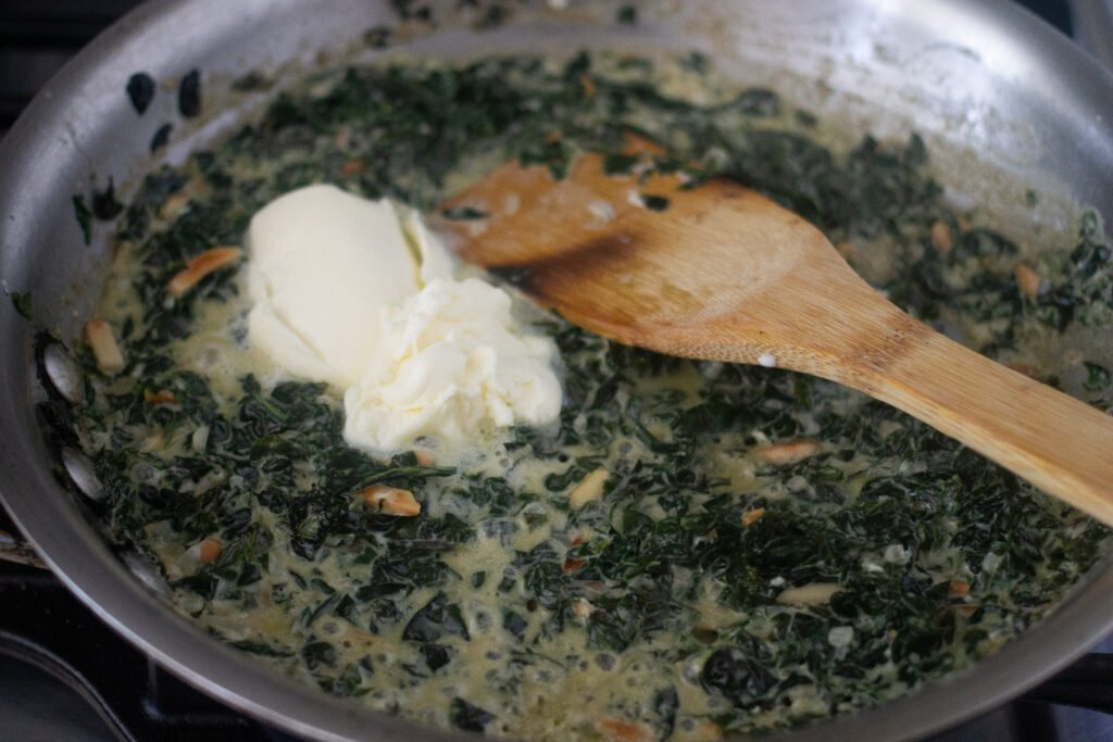 Kale in pan with cream cheese.