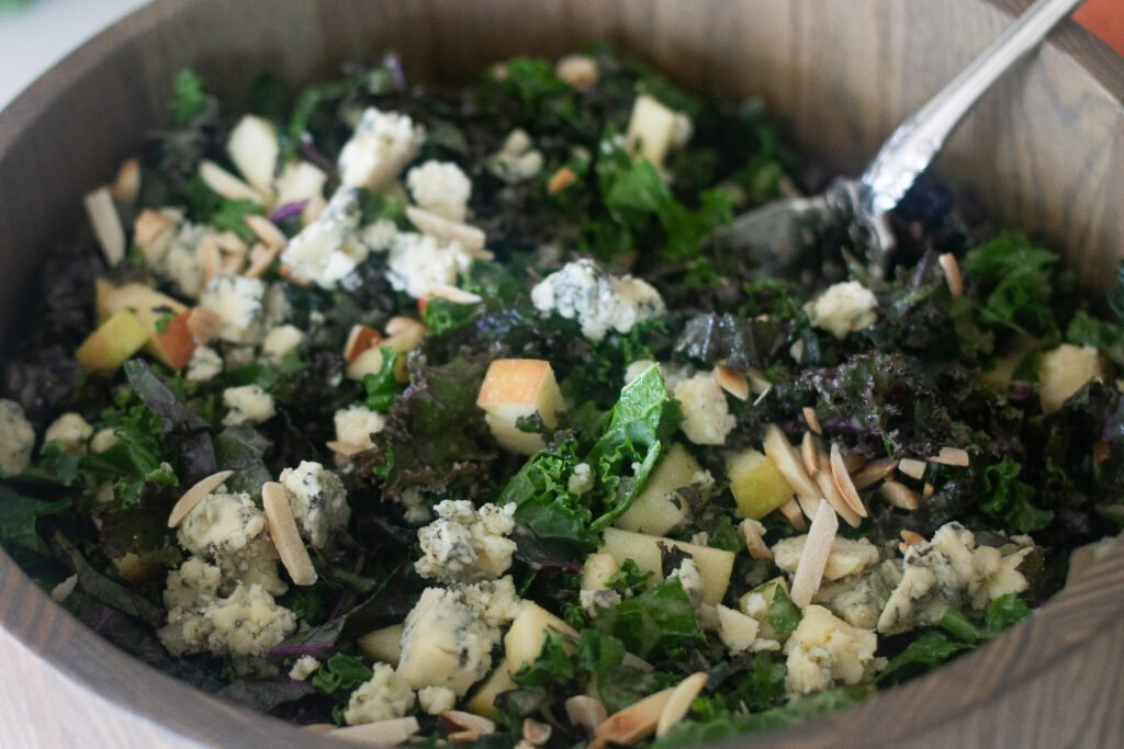 Kale salad with blue cheese and apples in bowl from Edible Times