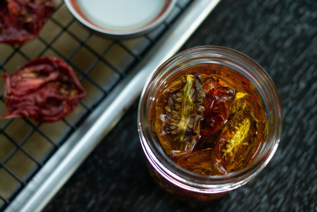 Oven-dried tomatoes in mason jar.