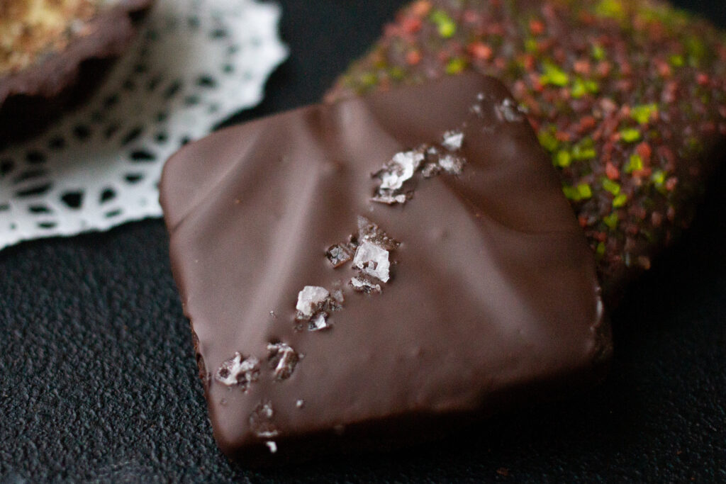 Chocolate shortbread cookie covered with chocolate, sprinkled with sea salt.