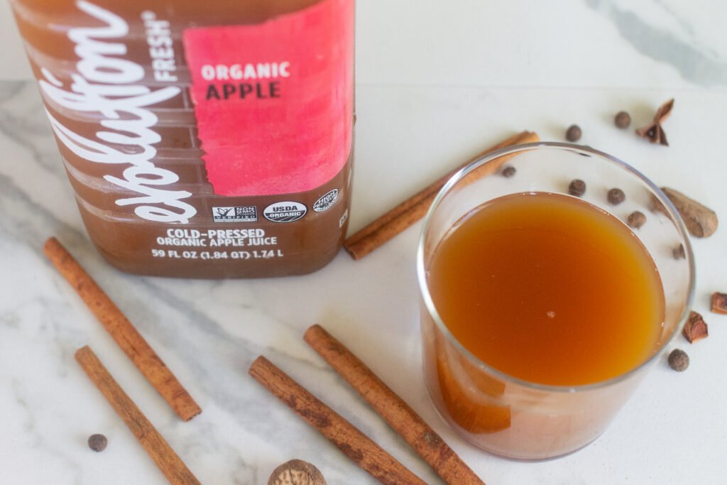 Evolution cold-pressed apple juice with whole spices for apple cider.