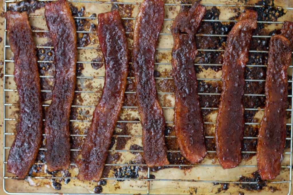 Candied bacon baked in the oven on a sheet pan.