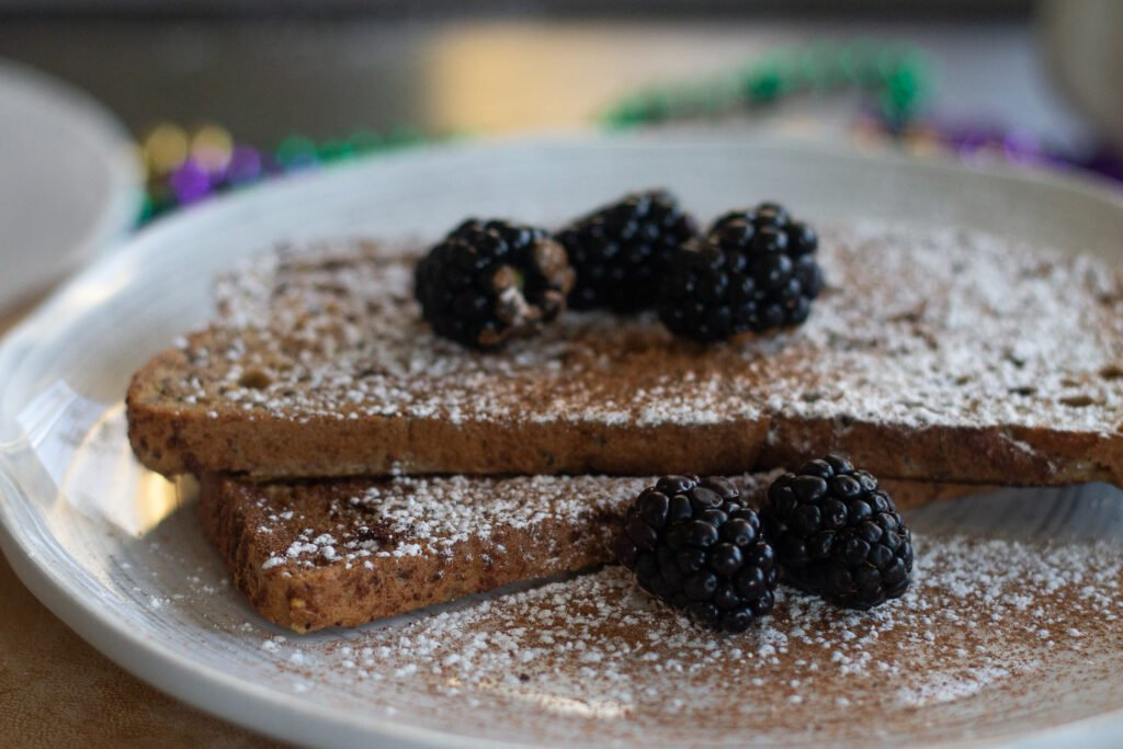 French toast with gluten-free bread on a white plate with blackberries.