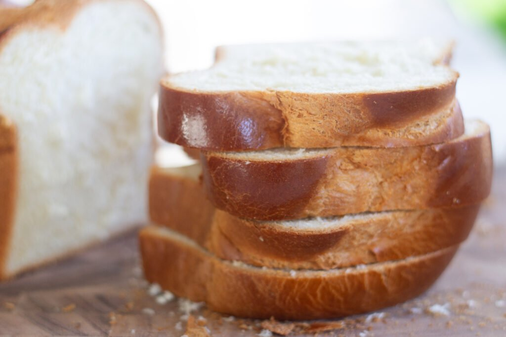 Thick slices of brioche on cutting board for French toast