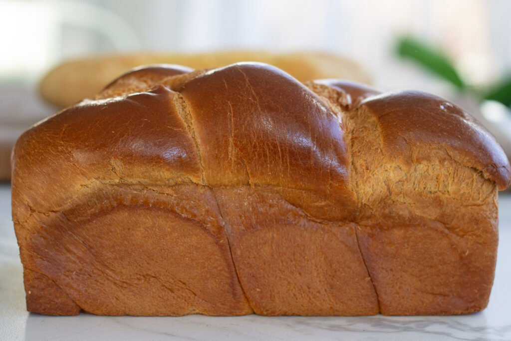 Loaf of brioche bread on table for French toast.