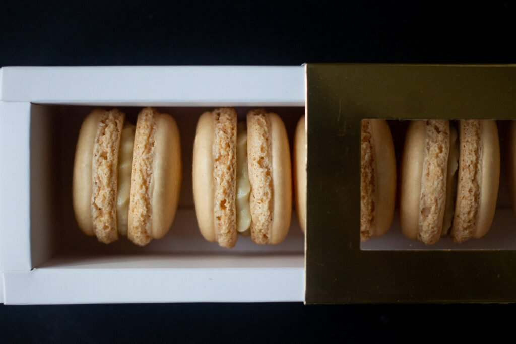 French macarons in a gold box.