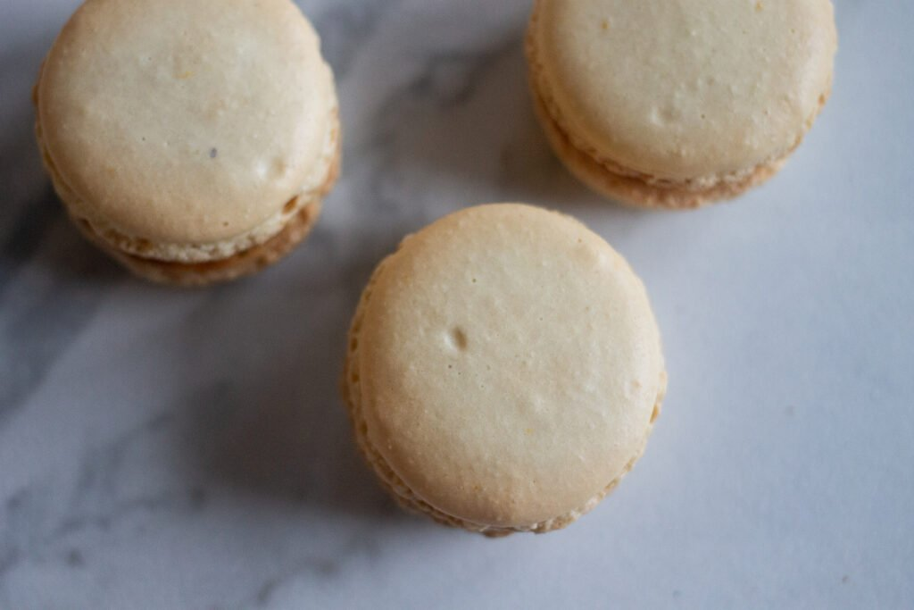 French macarons with small indentations that were tapped hard on the counter.