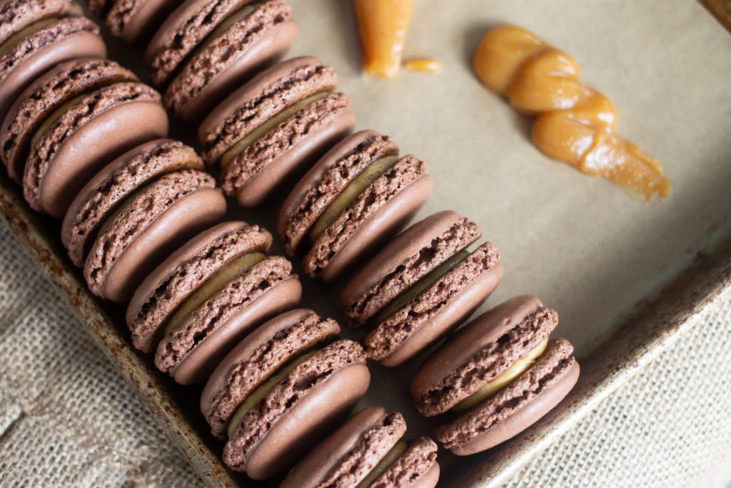 Chocolate peanut butter macarons with peanut butter buttercream.