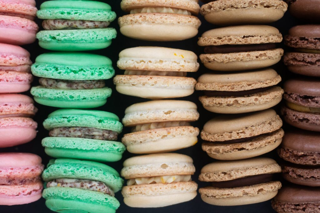 Five different French macarons flavors: strawberry margarita, mint chocolate chip, orange creamsicle, mocha, chocolate peanut butter