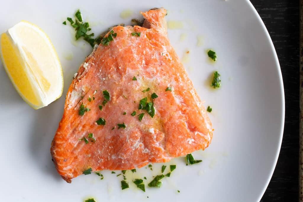 Grilled salmon on a plate with lemon vinaigrette