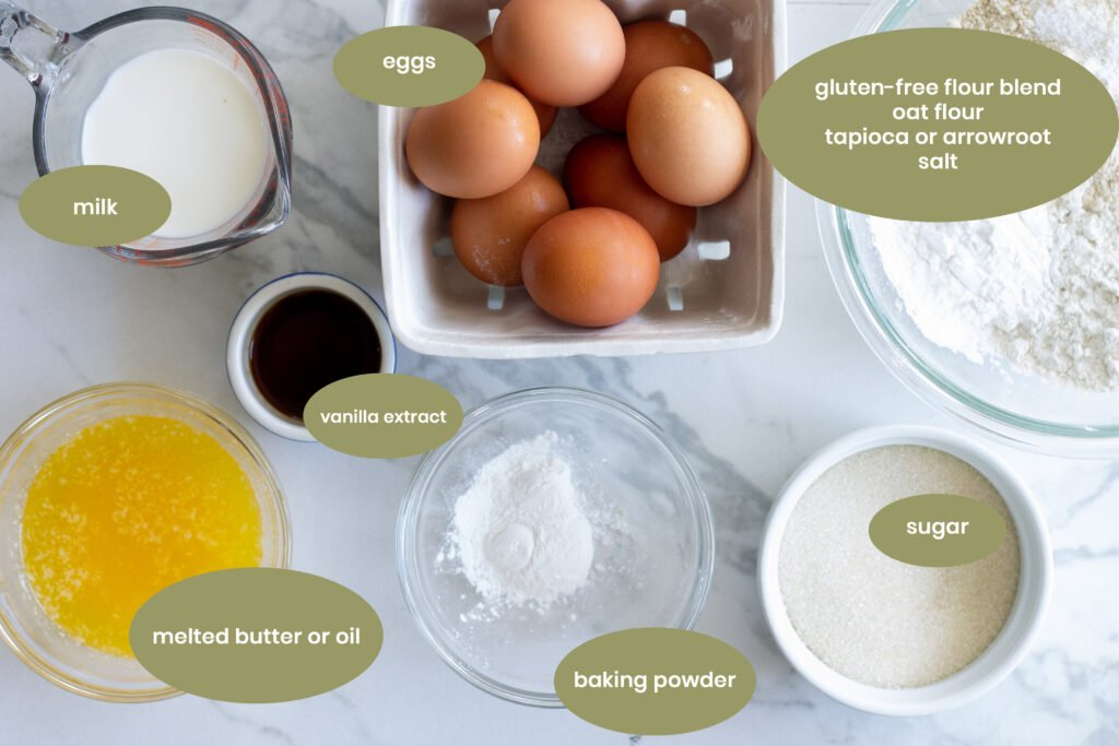 Ingredients for gluten-free vanilla cake on countertop in individual glass containers.