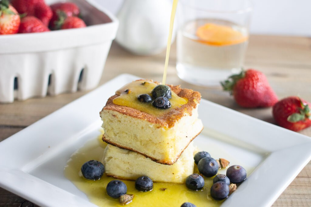 Low carb Japanese souffle pancake with blueberries and melted butter drizzling on top.