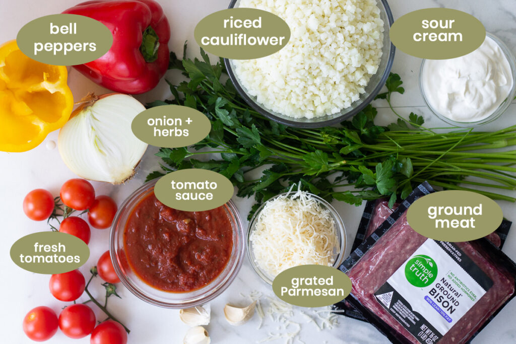 All listed ingredients for keto and low-carb stuffed peppers on counter.