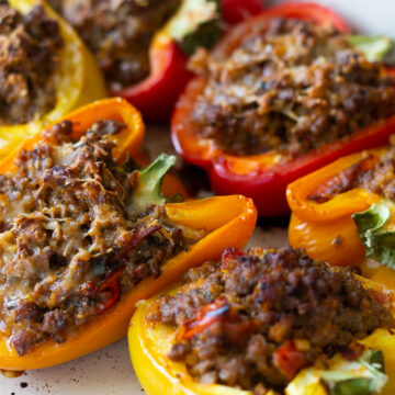 Keto stuffed bell peppers nestled in a baking dish.