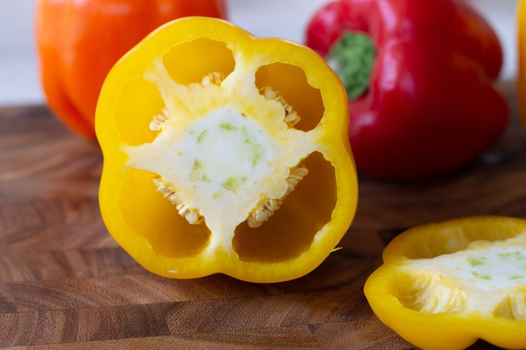 Looking into yellow bell pepper with top sliced off.