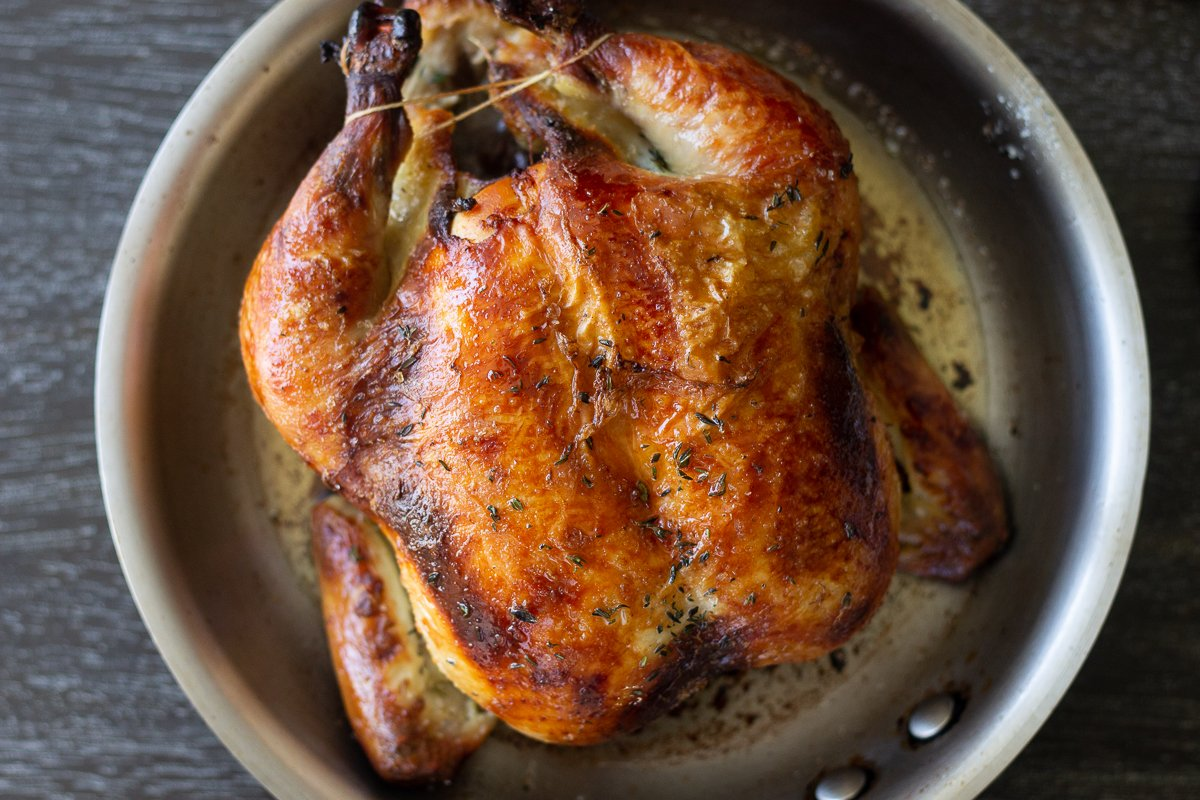 Whole roast chicken seasoned and cooked like at Thomas Keller's Bouchon Bistro.