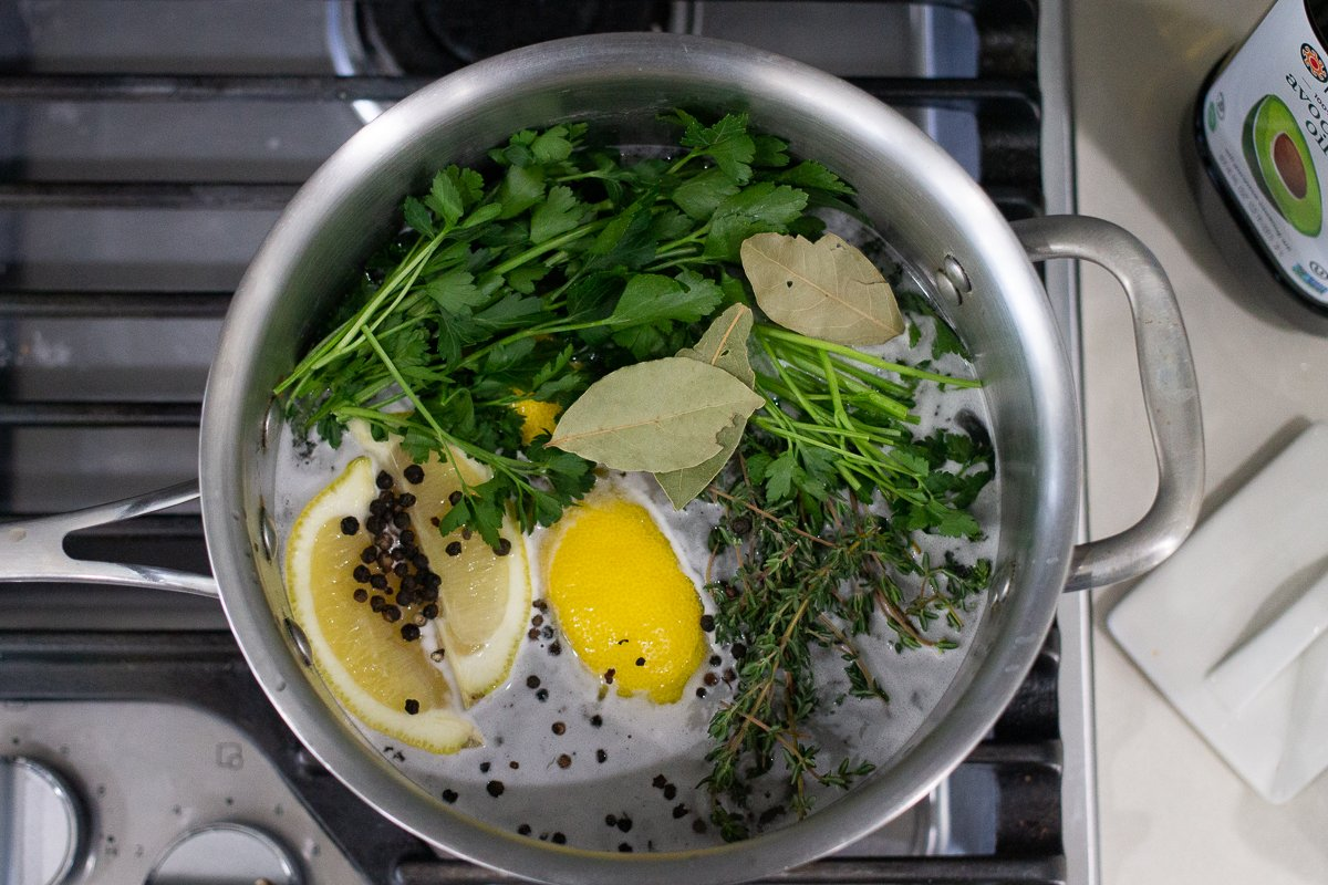 Ingredients for classic chicken brine in pot on stove.