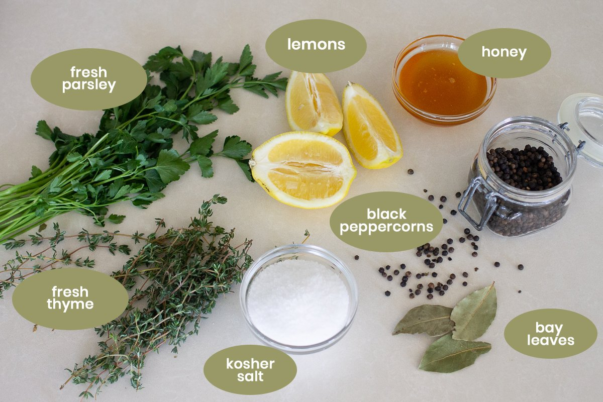 Photos of listed brine ingredients for Thomas Keller's roasted chicken on countertop.